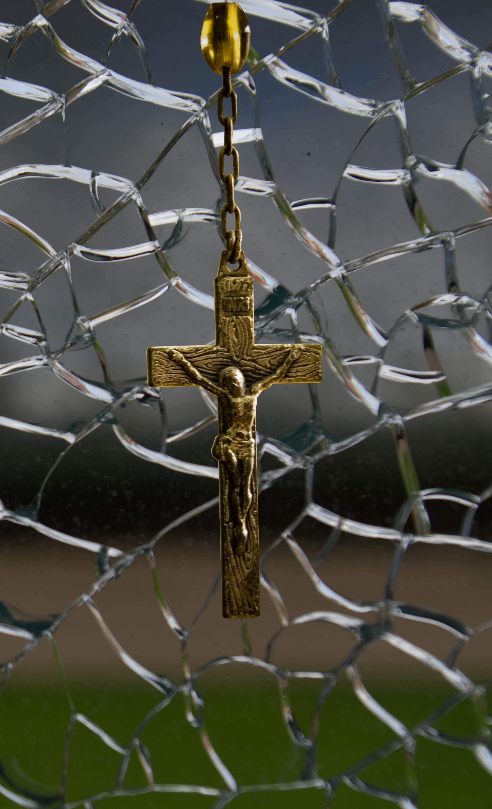 broken glass with cross